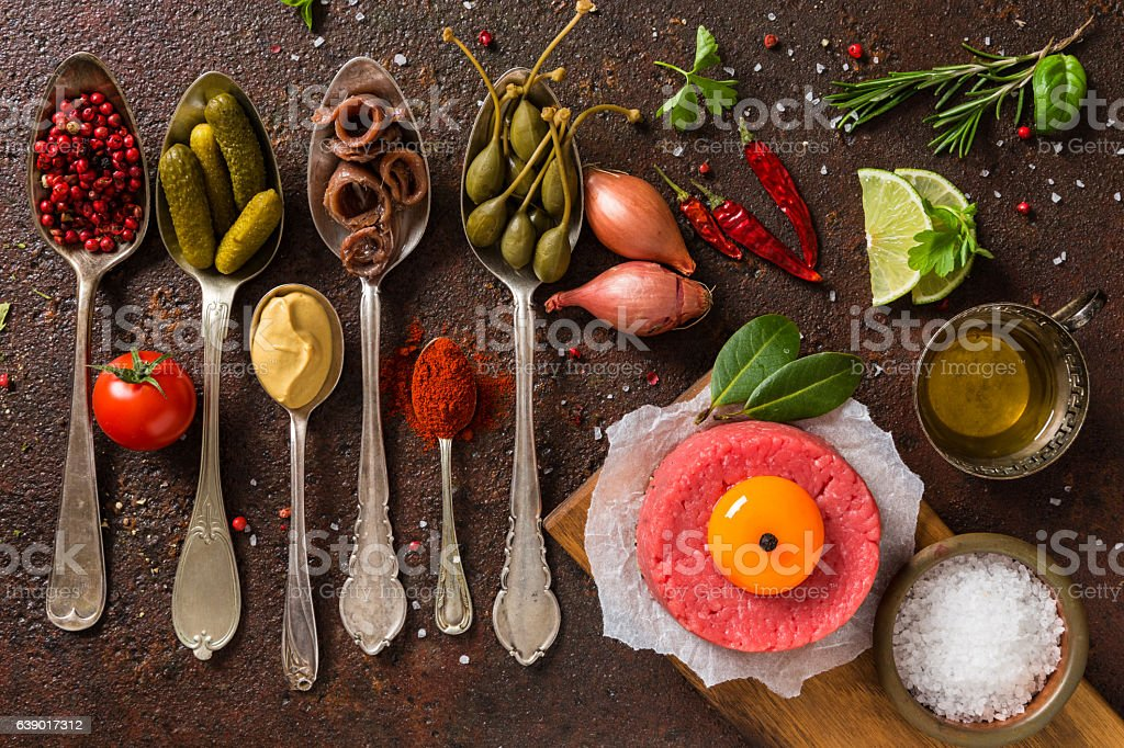 Minced meat with ingredients stock photo