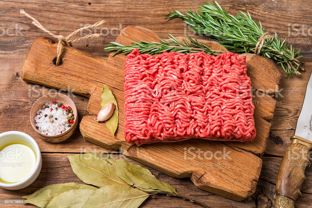 Minced meat  with seasoning and fresh rosemary stock photo