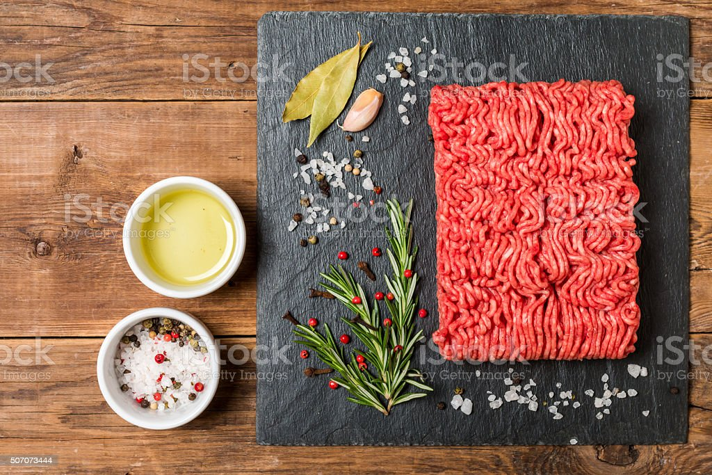 Minced meat  with seasonings and fresh rosemary stock photo