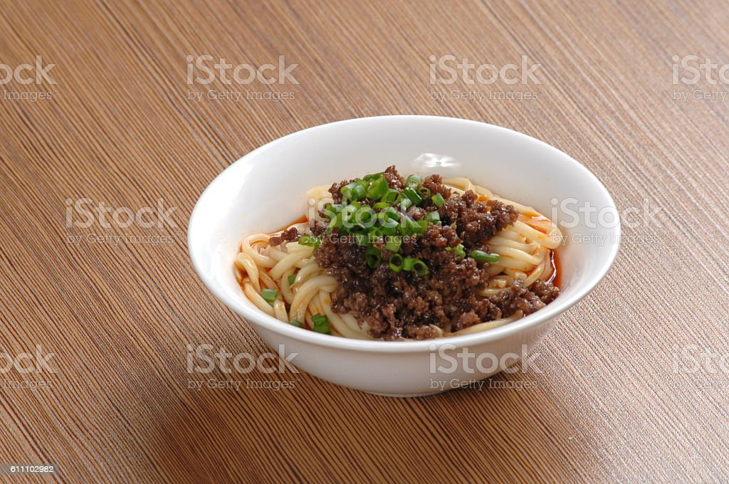 Minced pork noodles with chili oil sauce (臊子面) stock photo