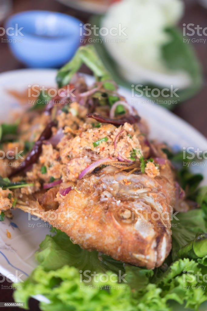 Minced Tilapia fish spicy salad with herbs stock photo