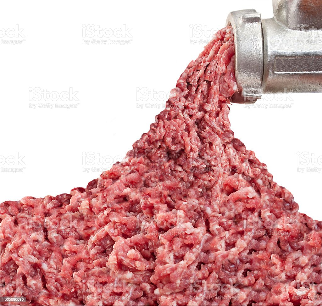 Mincer and a pile of chopped meat stock photo