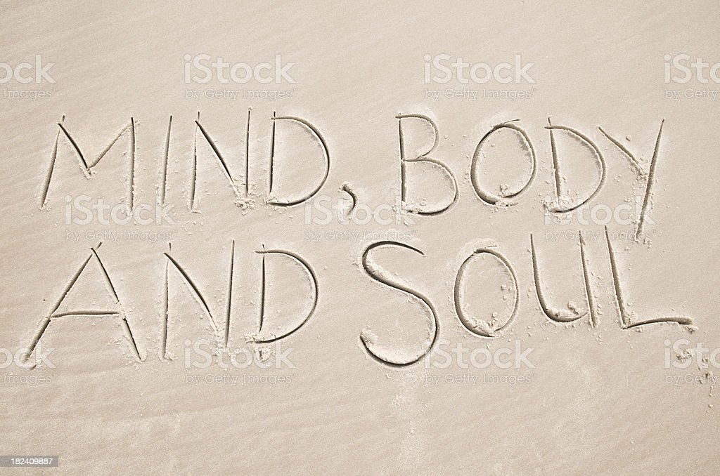 Mind Body and Soul Smooth Sand Message on Beach stock photo