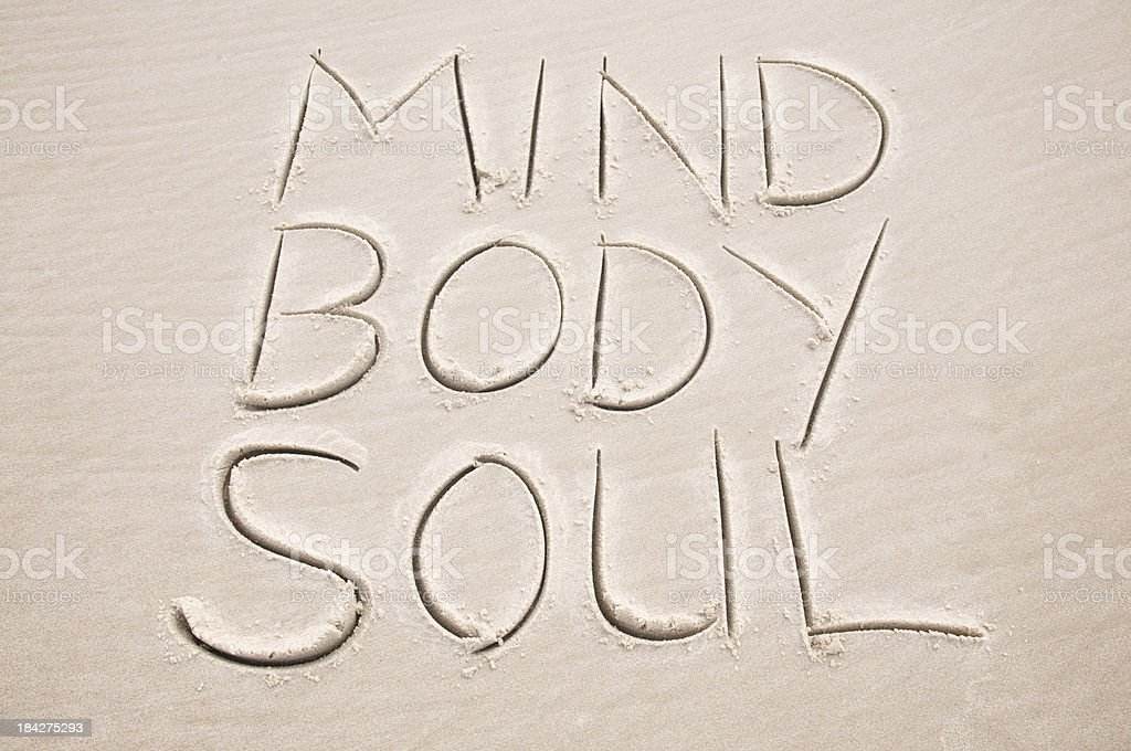 Mind Body Soul Inspiration Message Handwritten in Sand stock photo