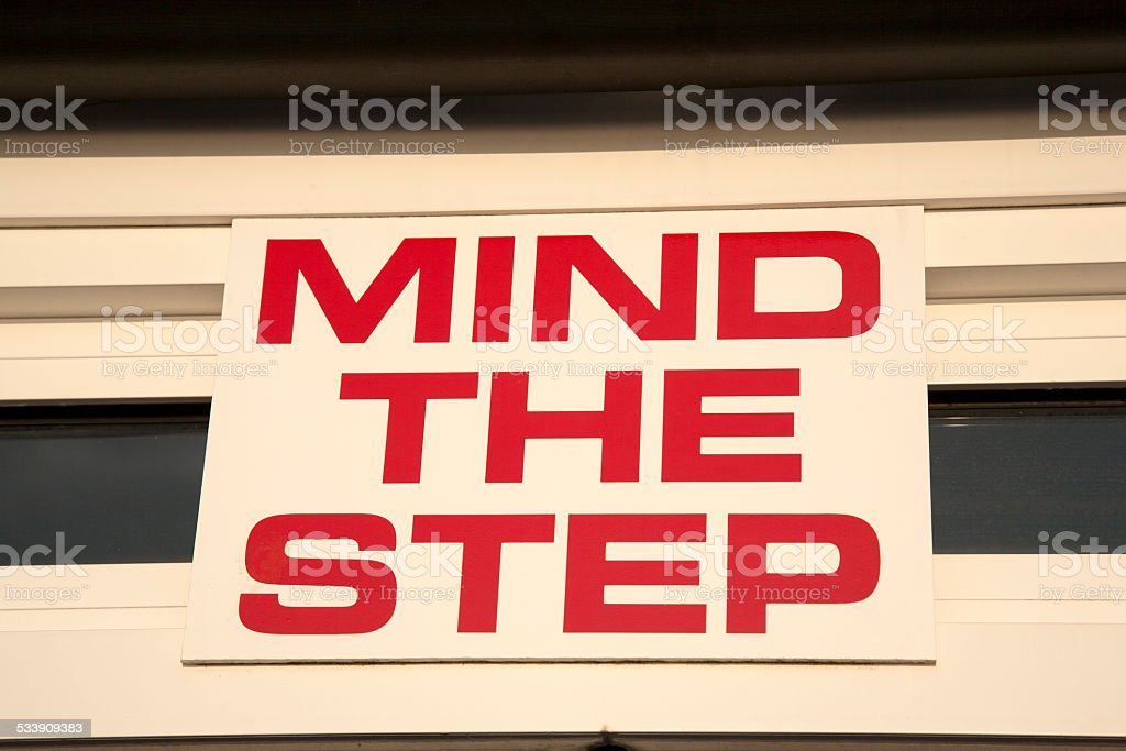 Mind the Step Sign stock photo