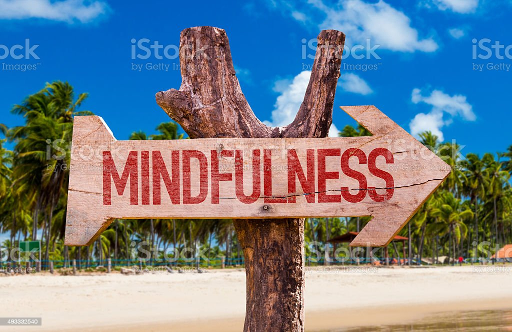 Mindfulness arrow with beach background stock photo
