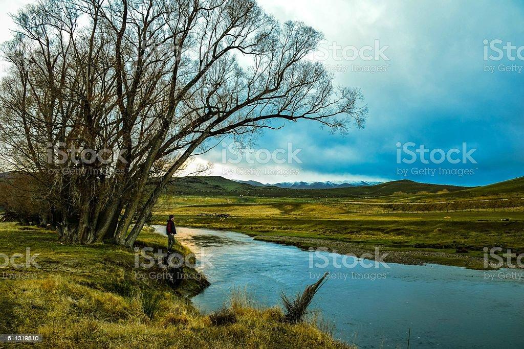 Mindfulness man looking at rural New Zealand royalty-free stock photo
