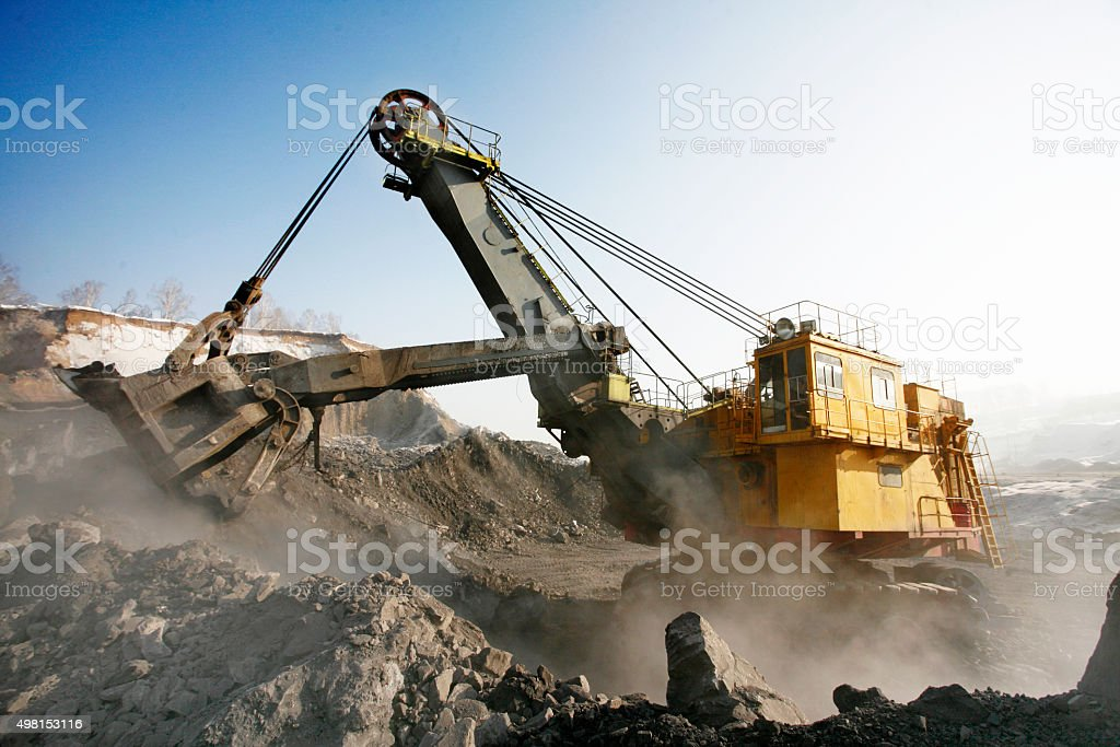 Mine excavator at work stock photo