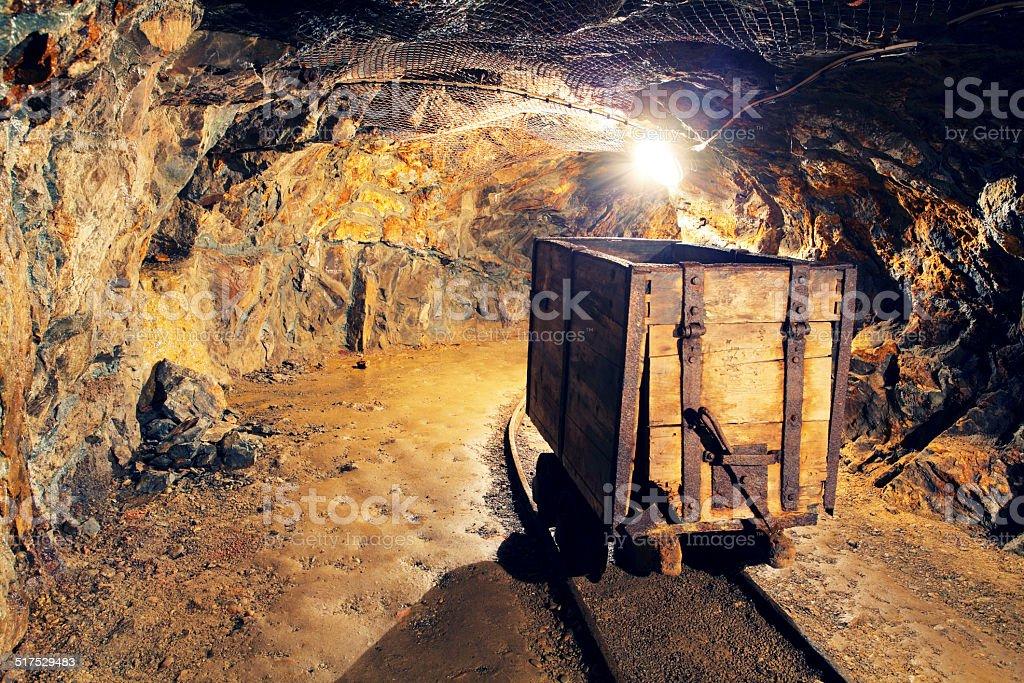 Mine gold underground tunnel railroad stock photo