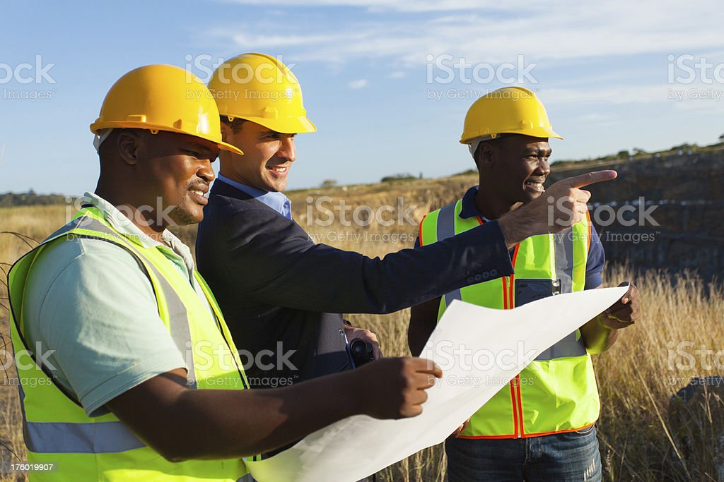 mine manager and worker at quarry stock photo