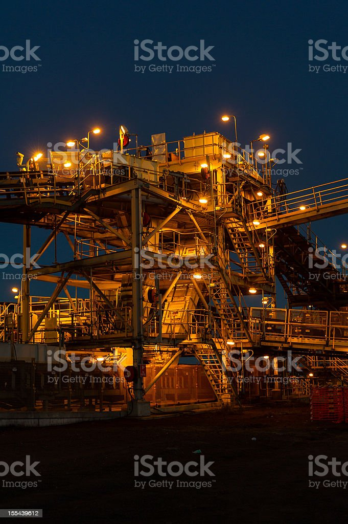Mine processing infrastructure at sunrise royalty-free stock photo