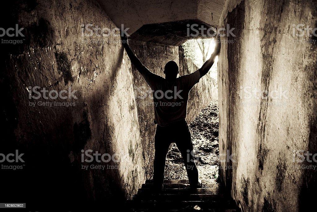 mine worker - dark gloomy dungeon of despair stock photo