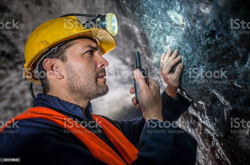 Miner talking on a walkie-talkie stock photo