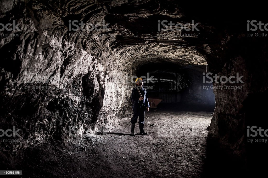 Miner working at a mine underground stock photo