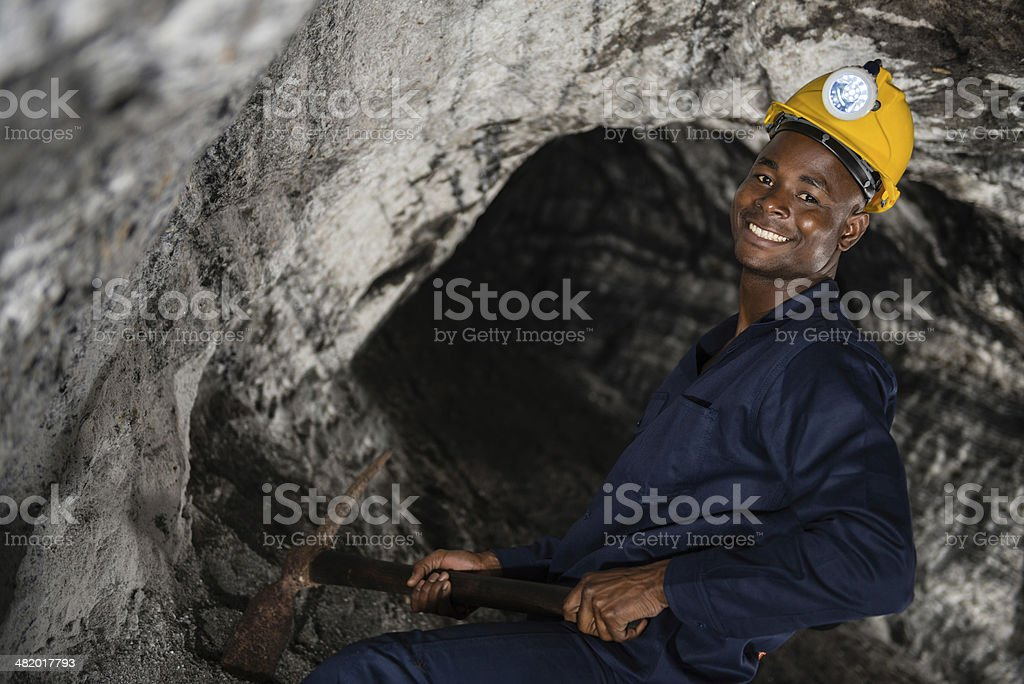 Miner working at the mine royalty-free stock photo