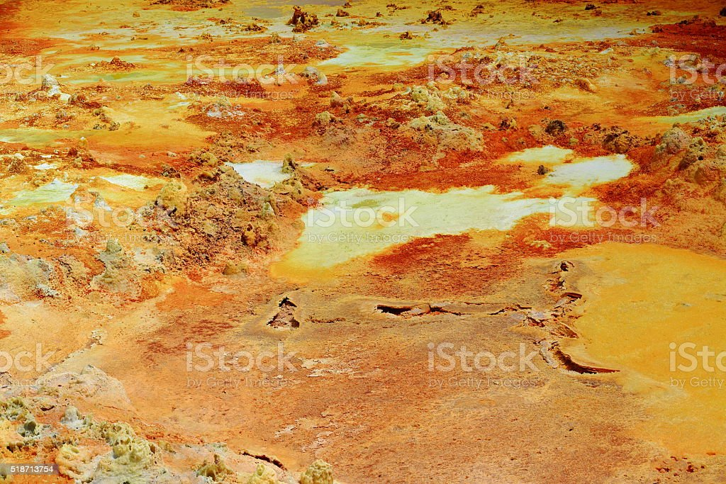 Mineral crust-Dallol mountain rising 50-60 ms.over Lake Karum-Assale. Danakil-Ethiopia. 0318 stock photo