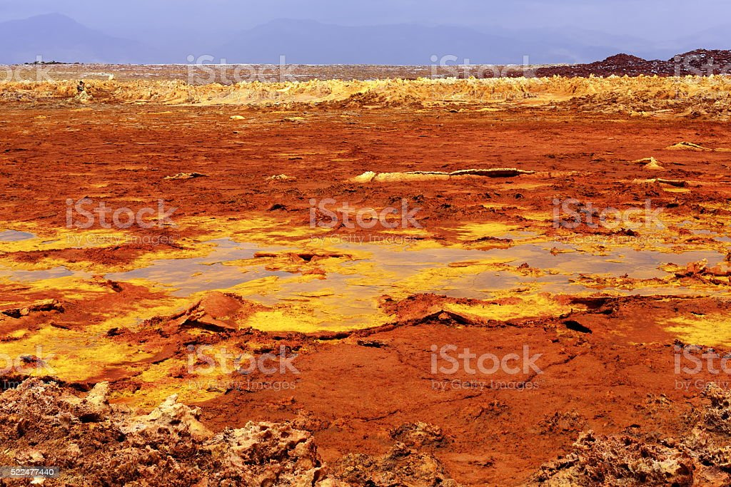 Mineral crust-Dallol mountain rising 50-60 ms.over Lake Karum-Assale. Danakil-Ethiopia. 0331 stock photo