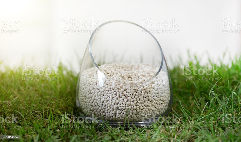 Mineral fertilizer on grass stock photo
