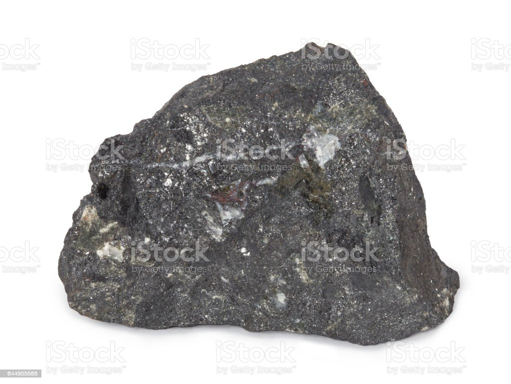 Mineral  magnetite isolated on white background. Magnetite is a mineral and one of the main iron ores. stock photo