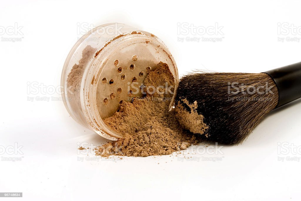 Mineral make-up spilled with brush royalty-free stock photo