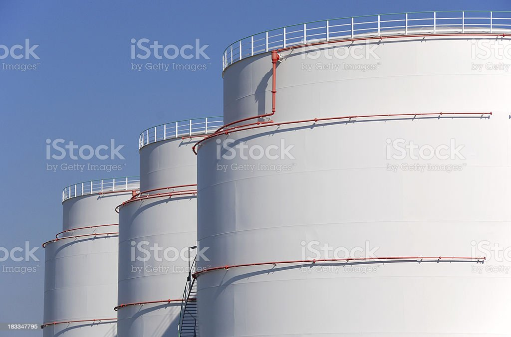 Mineral oil storage tank farm stock photo