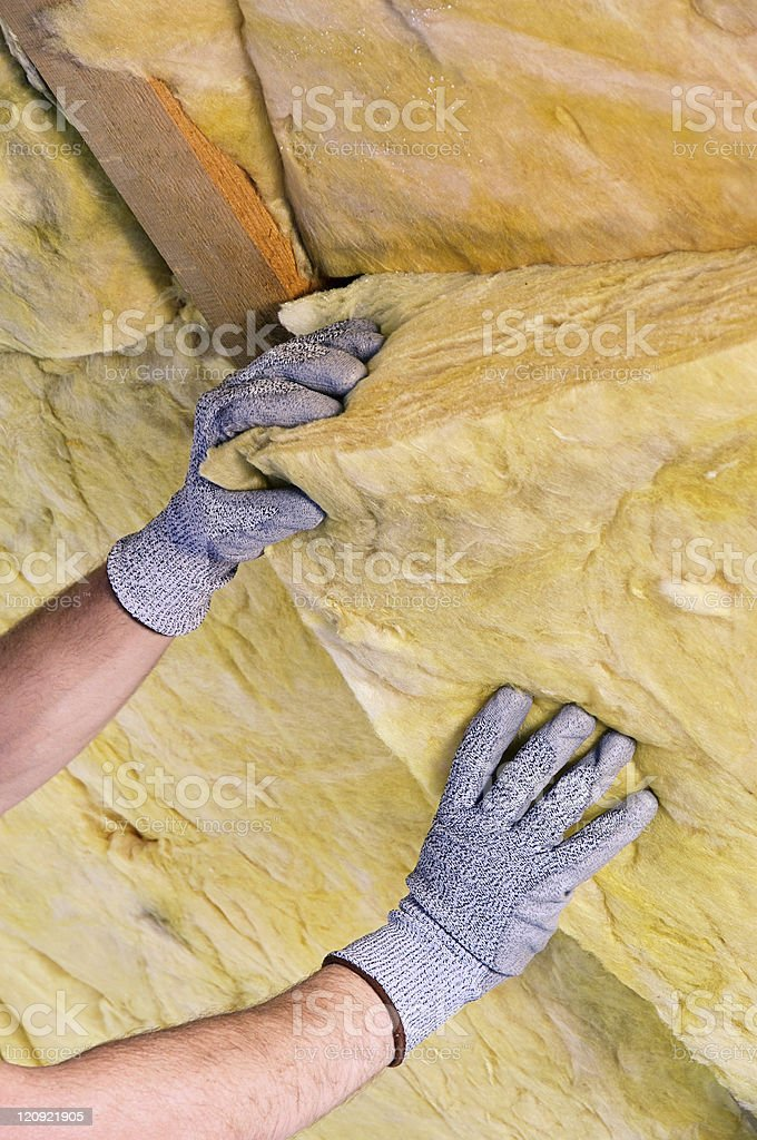 Mineral rock wool with a worker in gloves stock photo