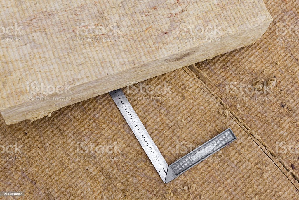 Mineral rockwool panels with metallic ruler stock photo