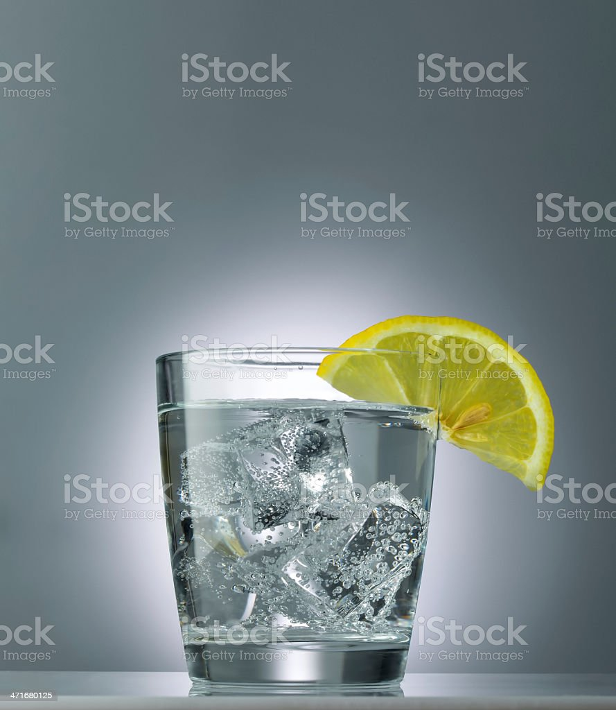 mineral water with ice and lemon close up stock photo