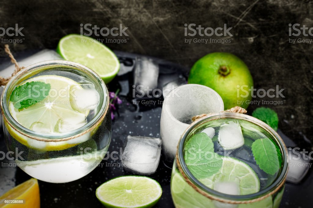 Mineral water with lemon and ice - healthy lemon juice stock photo