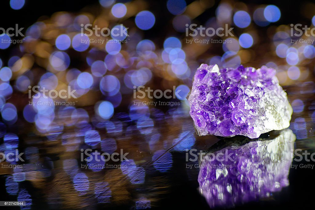 Minerals and crystals - purple Amethyst, magic bokeh light background stock photo