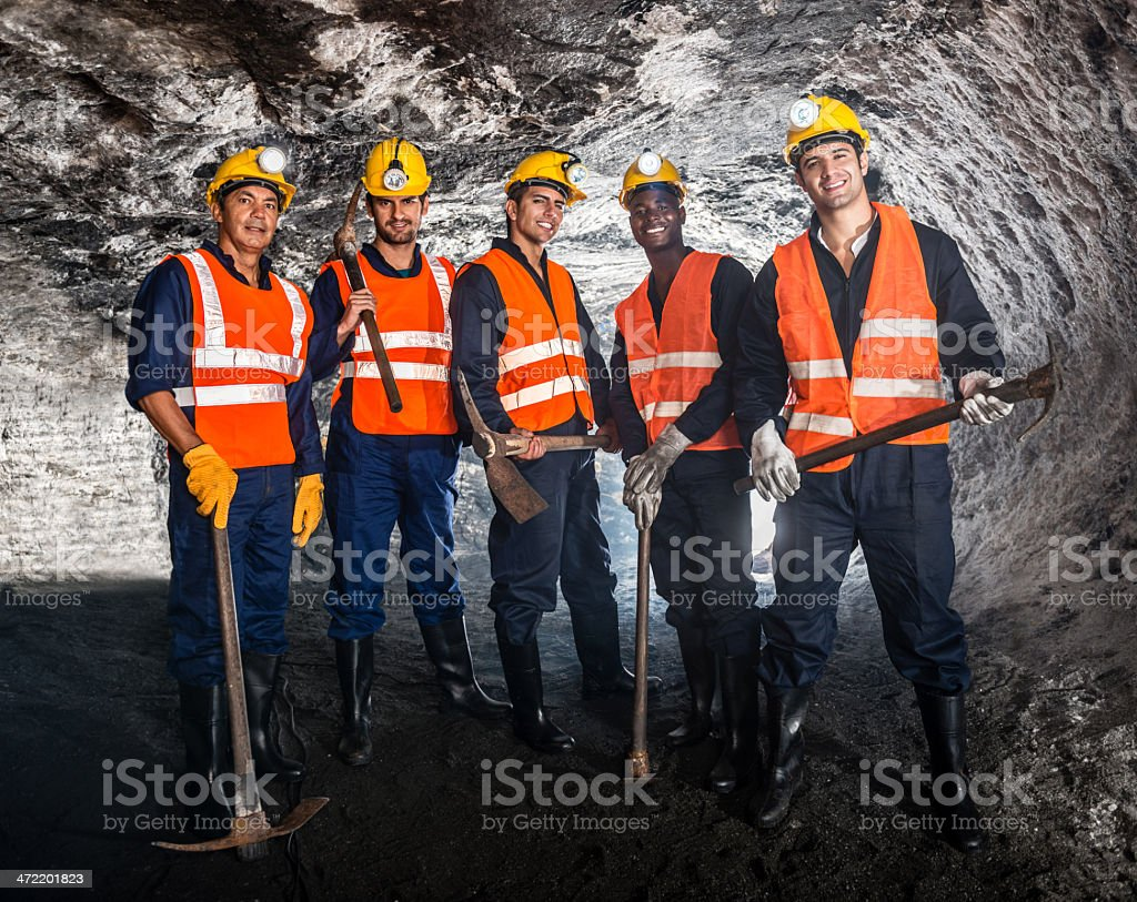 Miners and pick axes stock photo