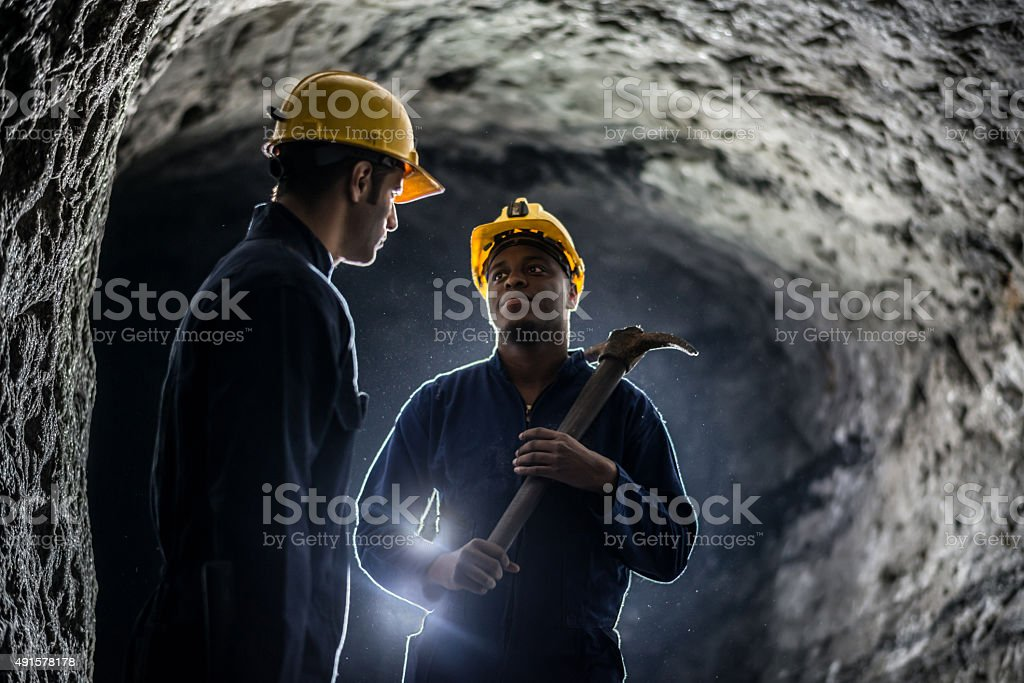 Miners working at a mine stock photo