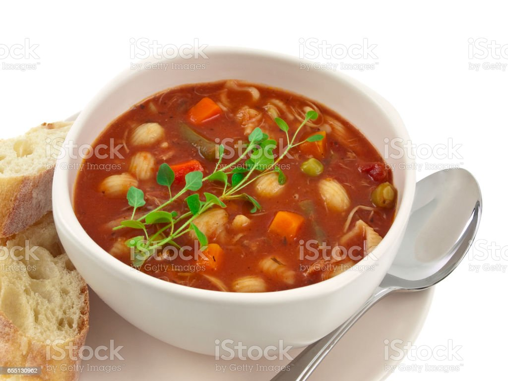 Minestrone soup bowl with bread isolated on white background stock photo