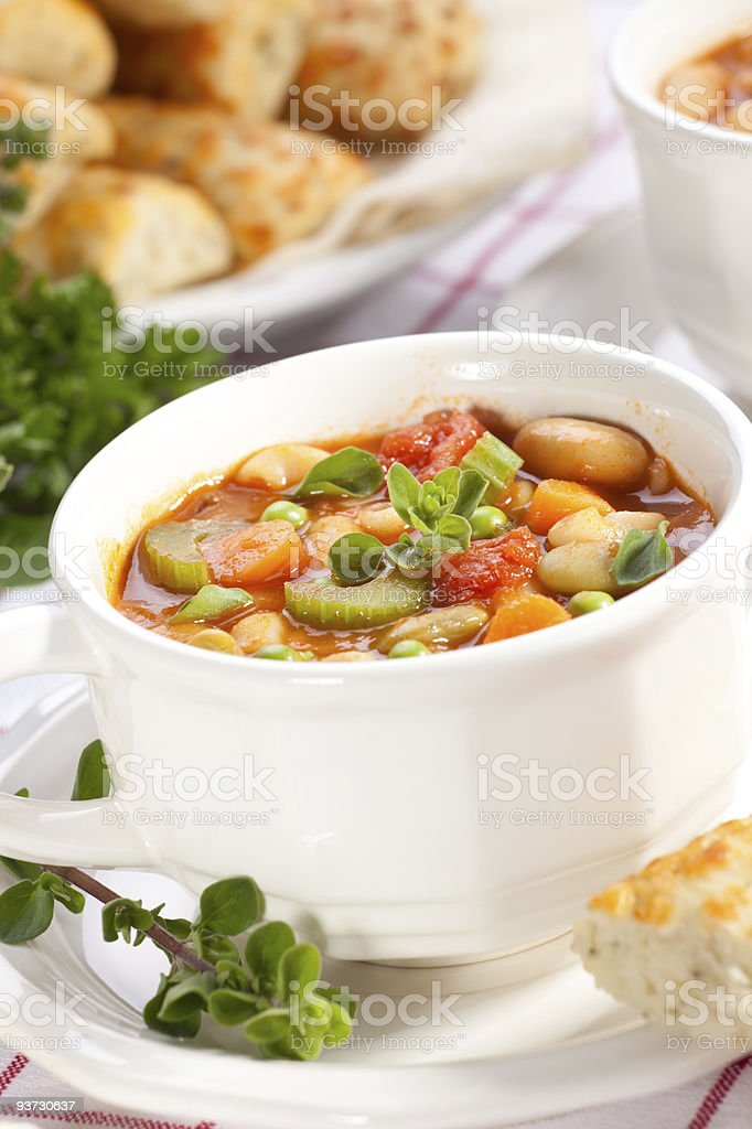 Minestrone soup with bread in background royalty-free stock photo