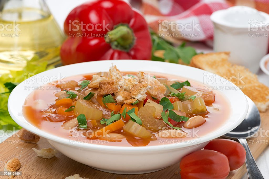 minestrone with vegetables, tomatoes, beans and croutons stock photo