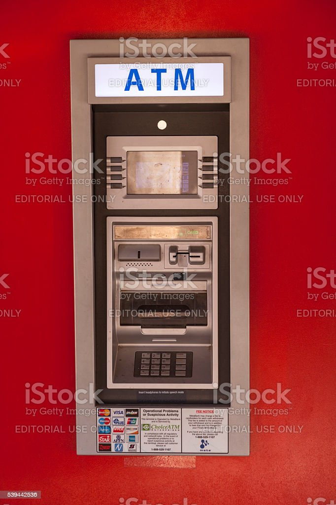Mini ATM in the wall stock photo