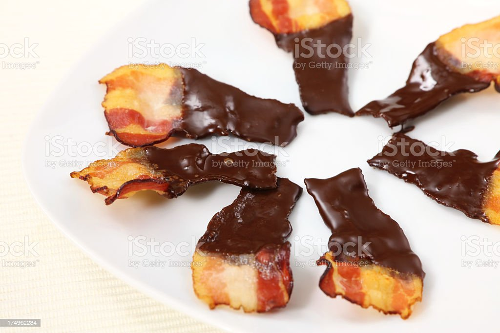 Mini bacon pieces covered in chocolate stock photo