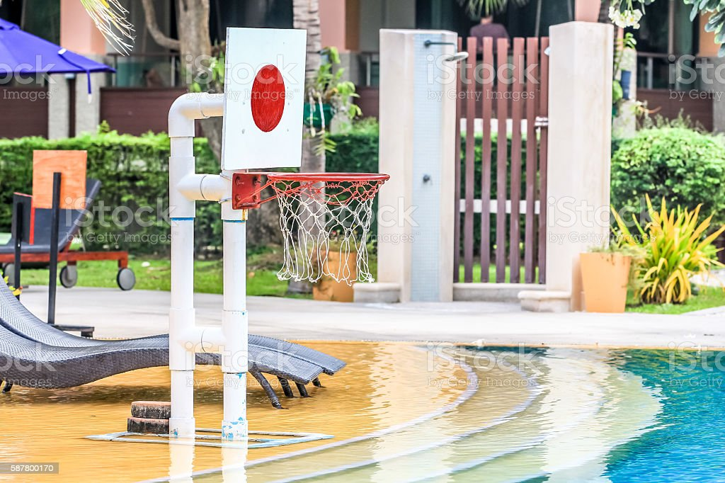 mini basketball hoop on the swimming pool for playing stock photo