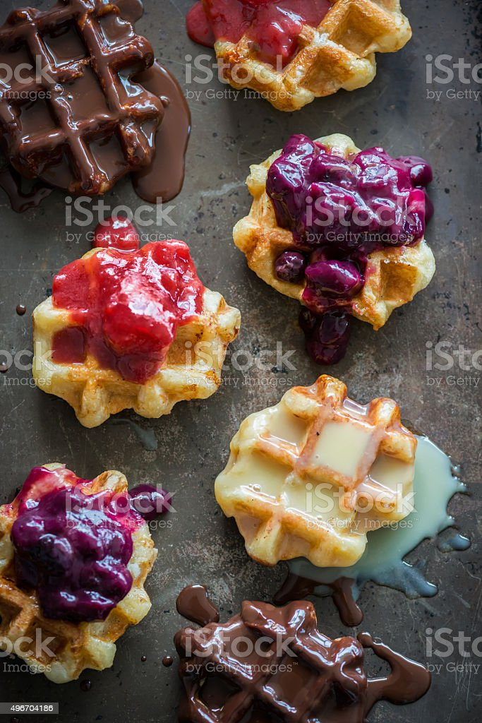 Mini Belgium Waffles Topped with Berry and Chocolate Sauces stock photo