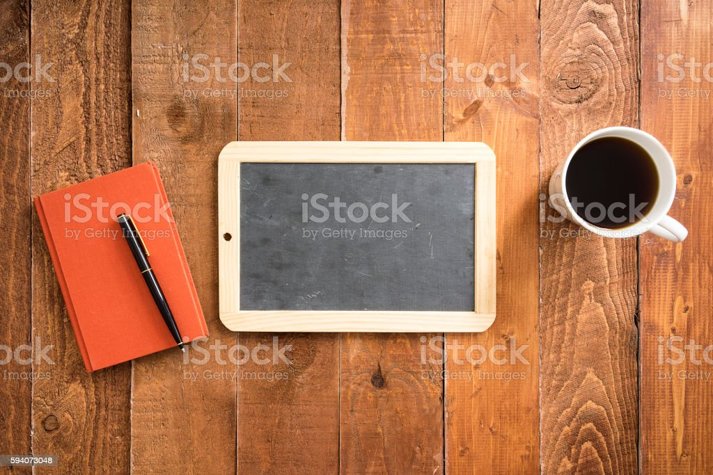 Mini blackboard on wooden plank background with coffee stock photo
