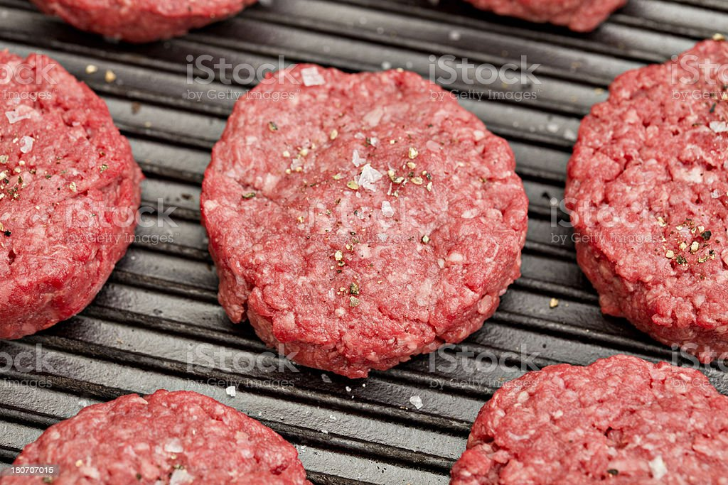 Mini Burgers On The Grill royalty-free stock photo