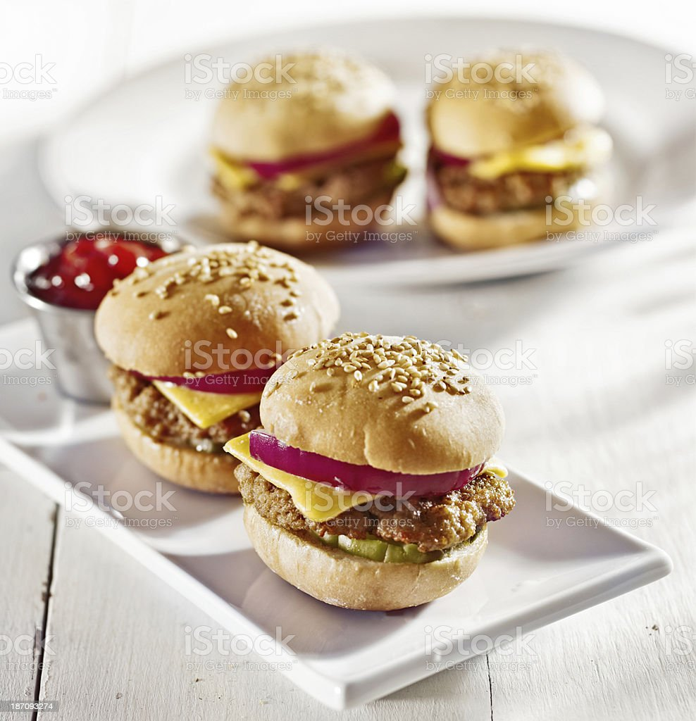mini burgers with cheese, onion and pickle. stock photo