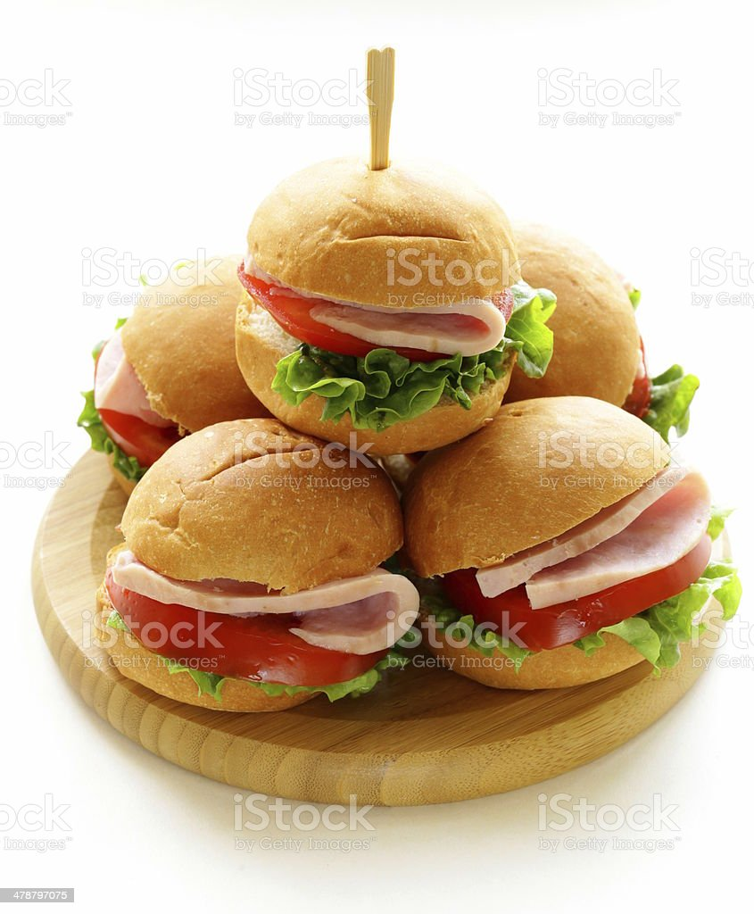 mini burgers with ham and vegetables - snacks for picnics stock photo
