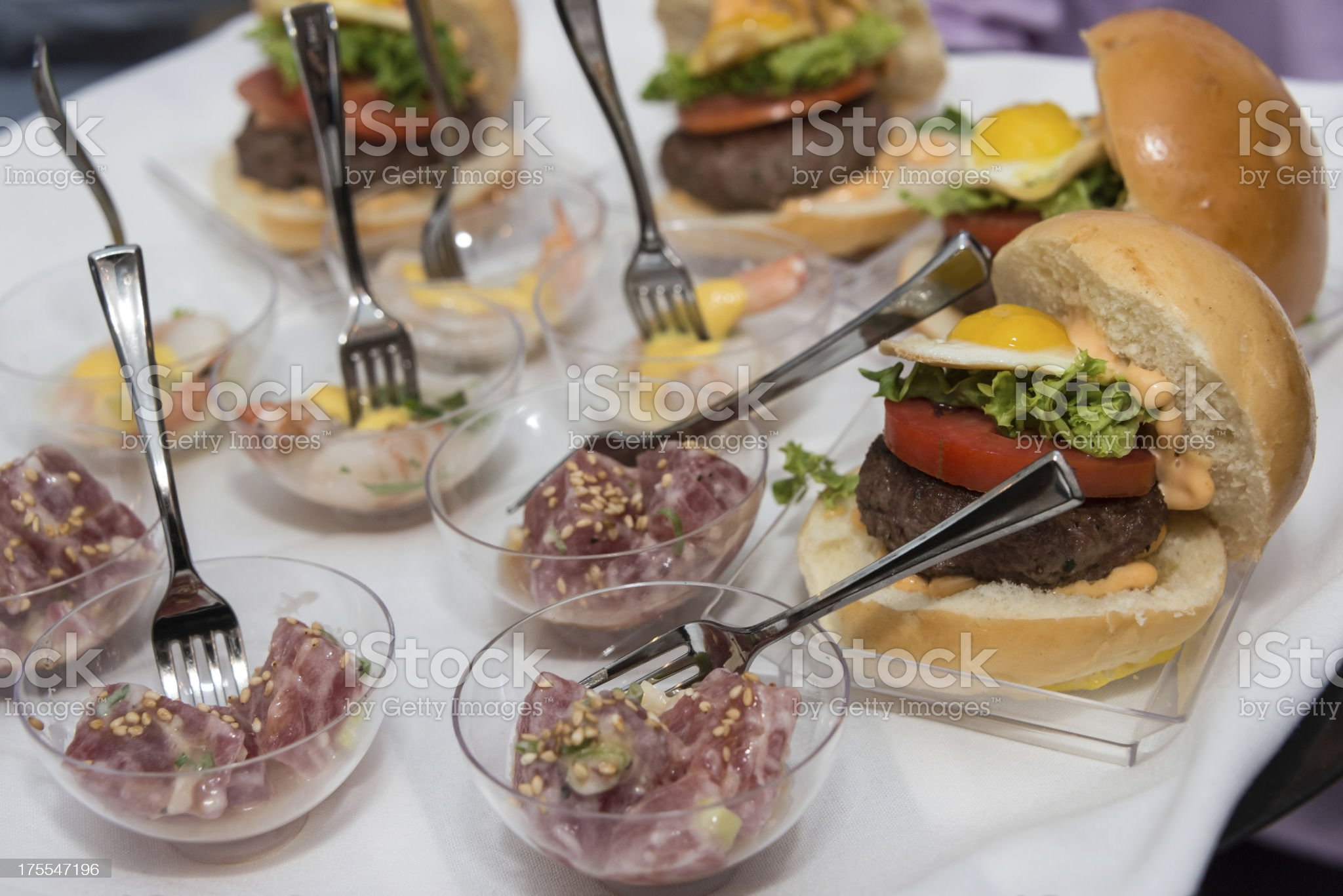 mini cheeseburger sliders with tuna bowls royalty-free stock photo