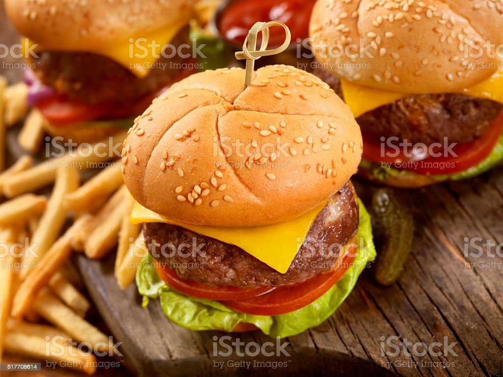 Mini CheeseBurgers with Fries and Beers stock photo