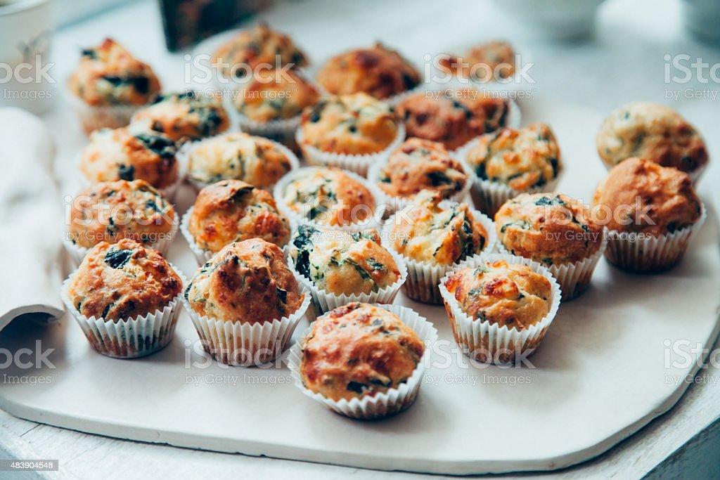 Mini cheesy veggy muffins stock photo