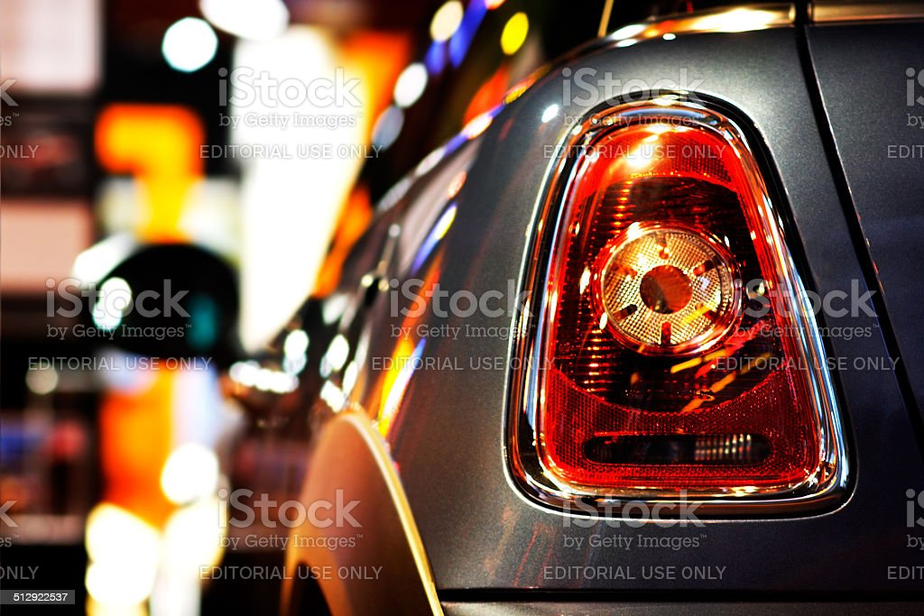 Mini Cooper vehicle at Night at public dealership shopping window stock photo