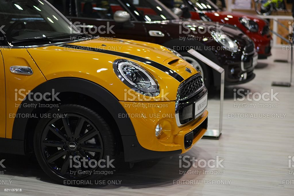 Mini Cooper vehicles in a row stock photo