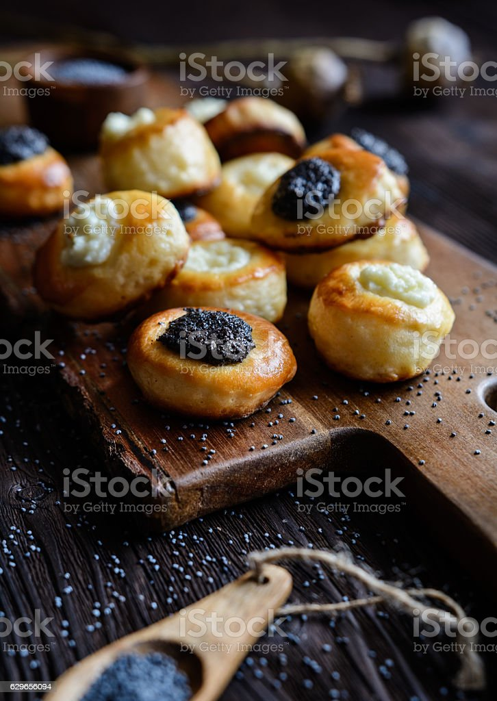 Mini curd and poppy seeds pies stock photo