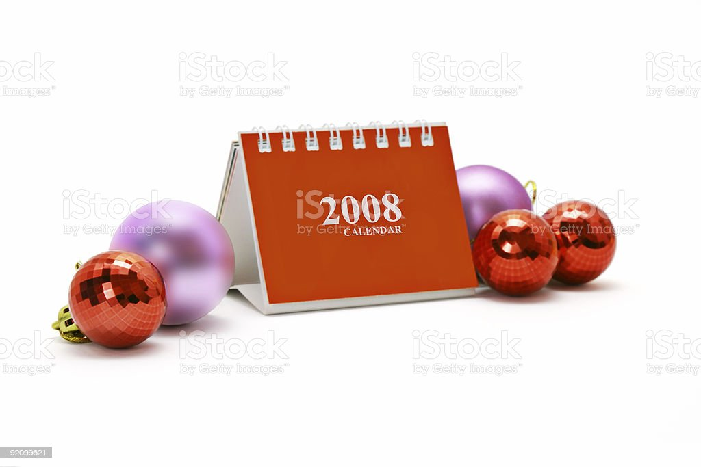 Mini desktop calendar and Christmas ornaments royalty-free stock photo